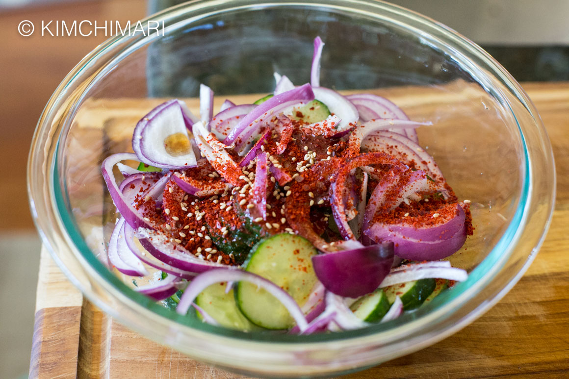 Asian Cucumber Salad Seasoned in glass bowl
