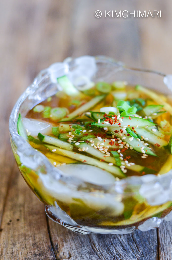 Korean Cold Cucumber Soup in bowl with cucumber in soy sauce broth with ice
