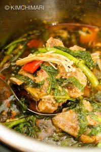 Instant Pot Gamjatang (Korean Pork Bone Stew) ladled inside pot
