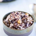 Cooked korean multigrain rice in ceramic bowl with silver spoon