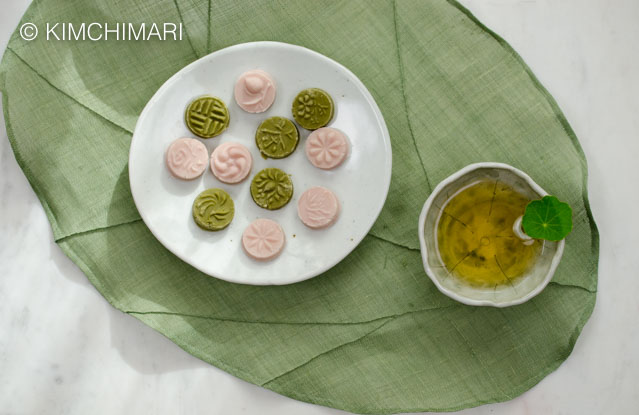 Plate of green tea and omija cookies with a cup of green tea