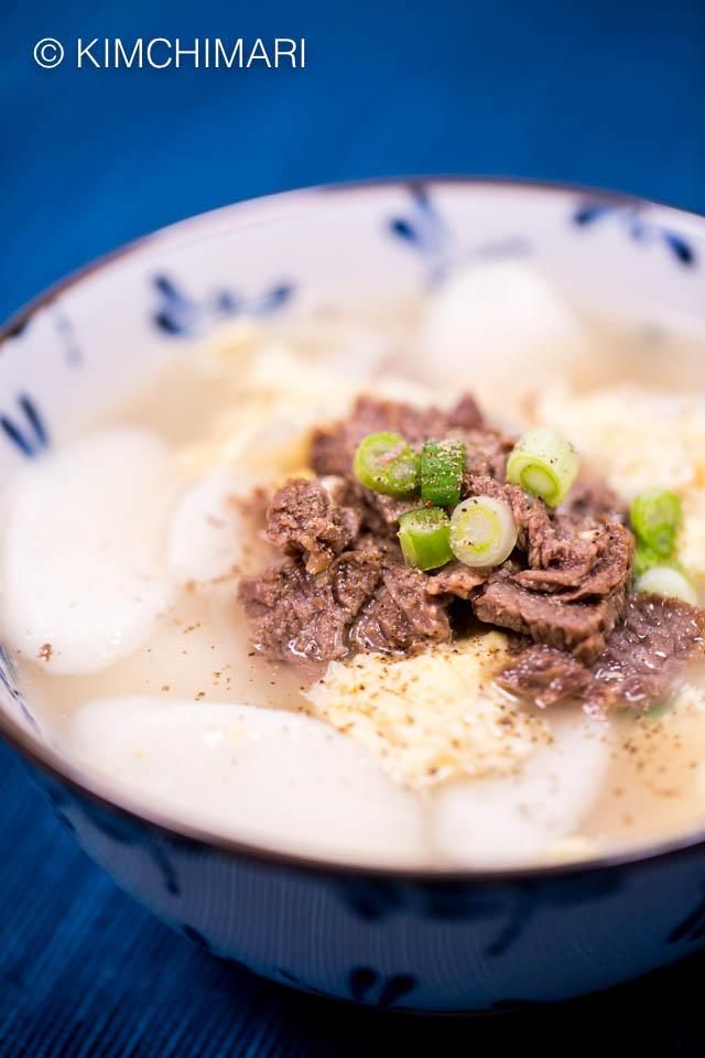 Tteokguk made in Instant Pot served in bowl with beef topping
