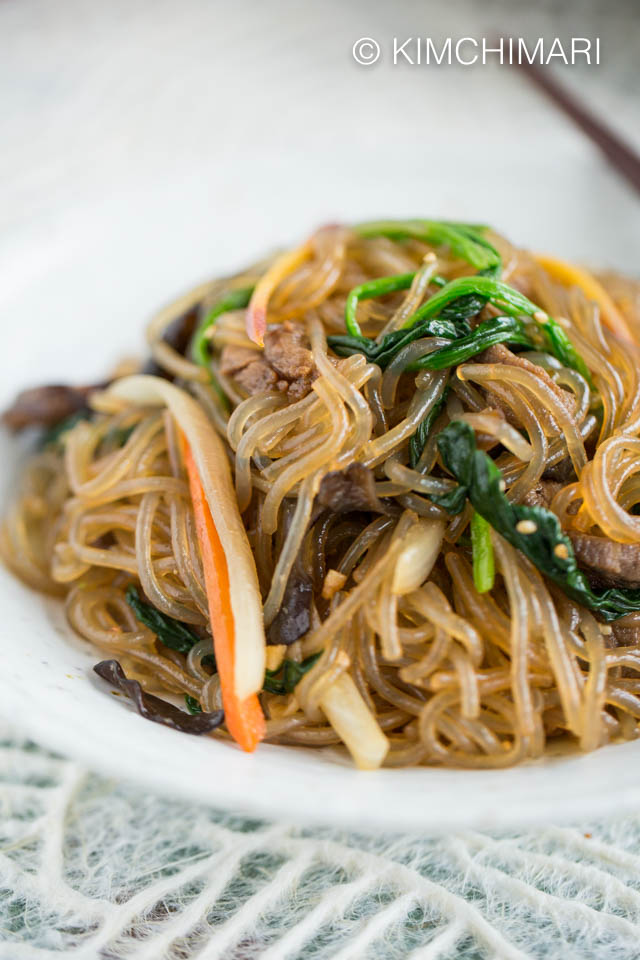 Japchae Glass Noodles with beef and vegetables plated closeup