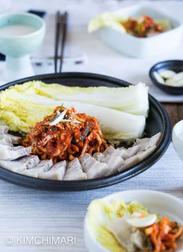 plate of pork belly cooked with Doenjang with cabbage and radish salad