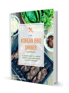 Korean BBQ Cookbook cover with Kalbi bbq spread in the background