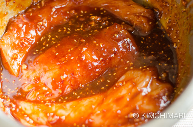raw chicken marinating in spicy gochujang sauce