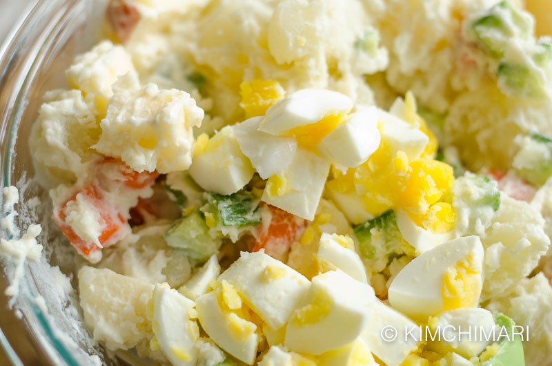 Korean potato salad mixed with eggs added on top