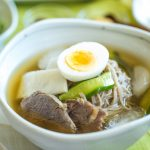 finish mul naengmyeon in a bowl with all toppings