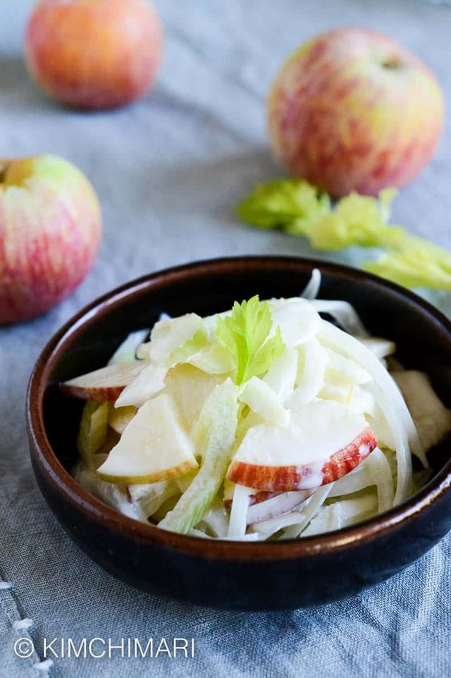 Apple Onion Celery tossed in creamy dressing served in dark brown bowl