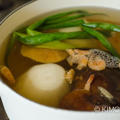 anchovy broth with all vegetables simmering in pot