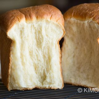 milk bread loaf split into two with side showing