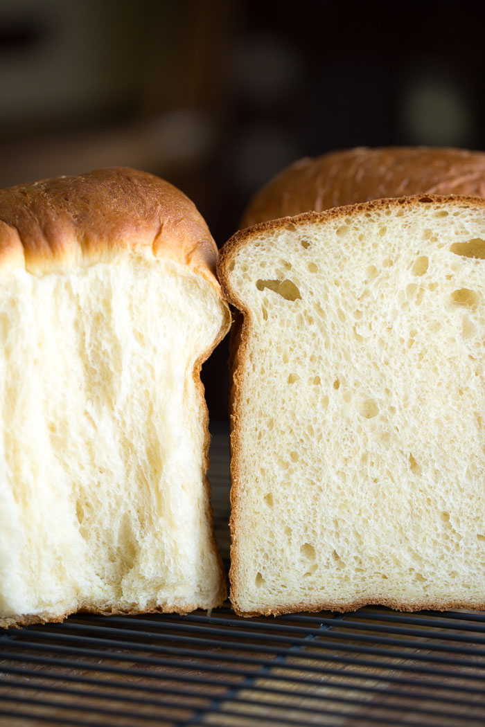 side closeup view of pulled apart and sliced milk bread