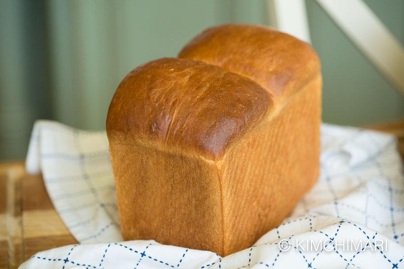 baked whole milk bread on kitchen towel