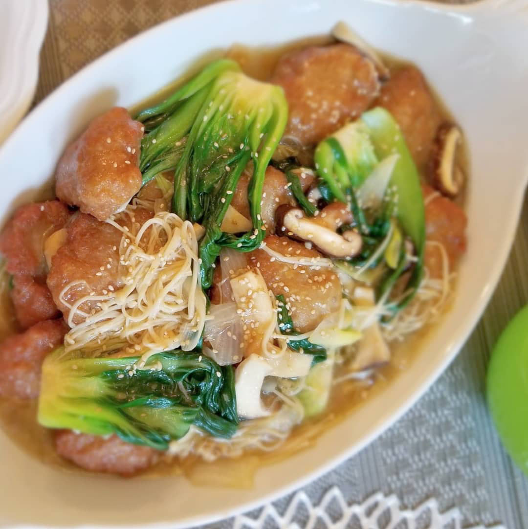 Nanja Wans meatballs plated with enoki mushrooms and bok choy
