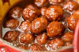Gochujang meatballs appetizer finished in pot with sauce
