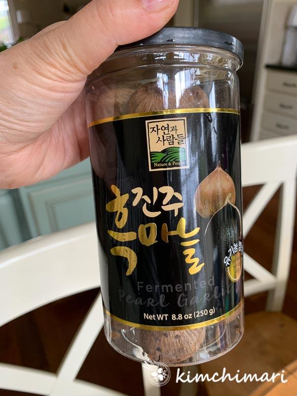 korean jinjoo black garlic in jar