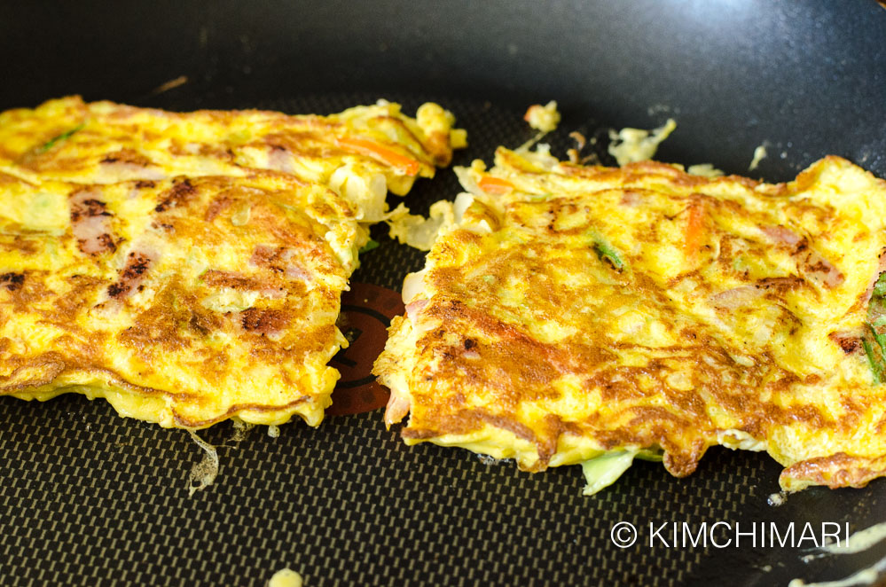 2 pieces of cooked egg omelette in non-stick frying pan