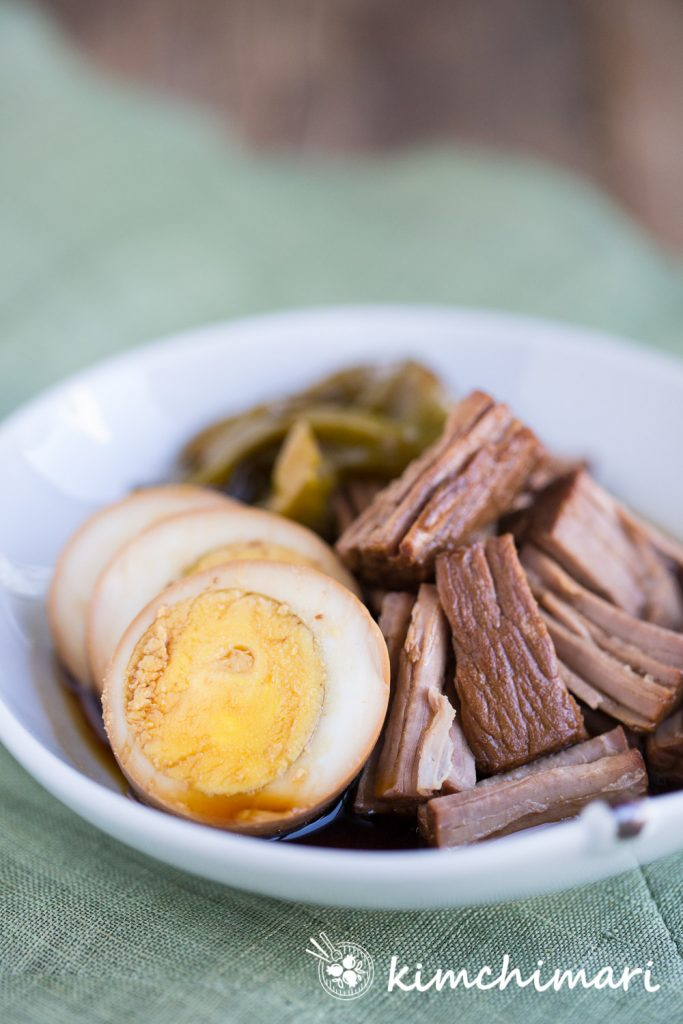 pressure cooker jangjorim plated with sliced egg and meat on green mat