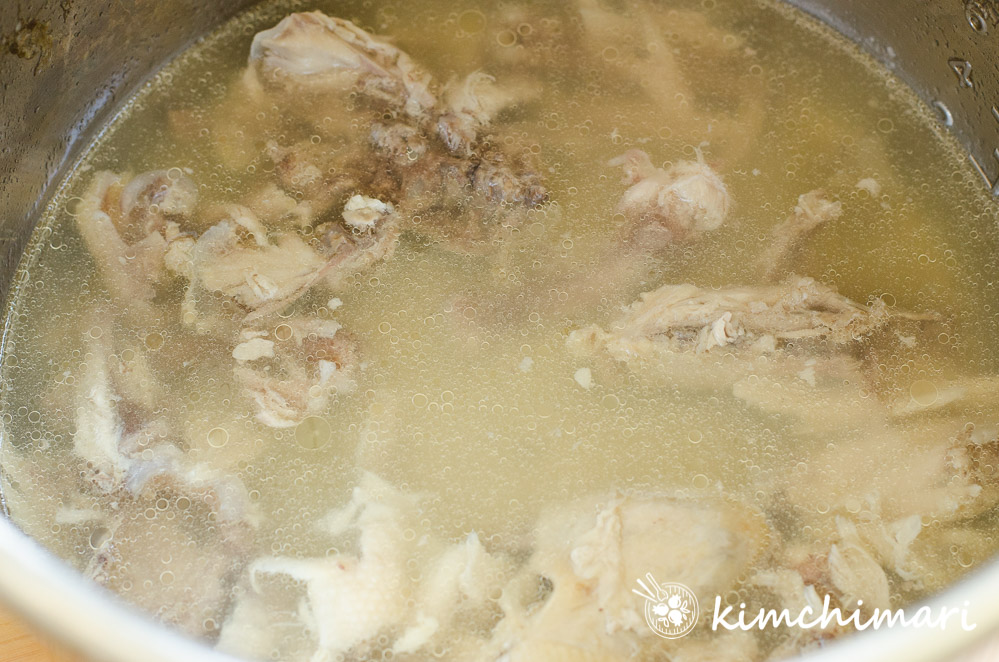 chicken bones in pot with broth for dakjuk