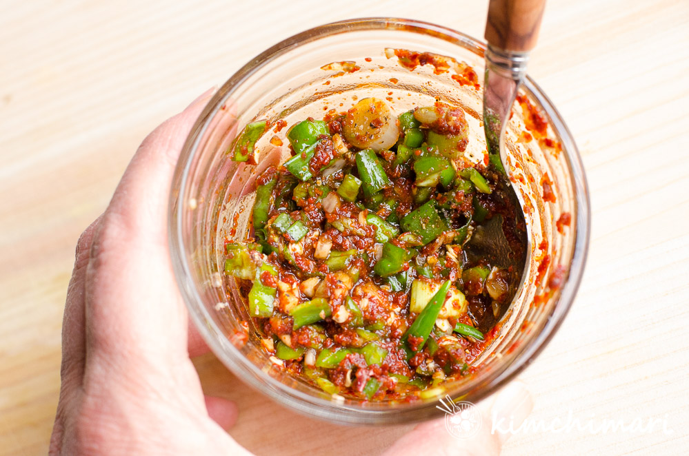 mixed sauce in glass bowl with a spoon inside