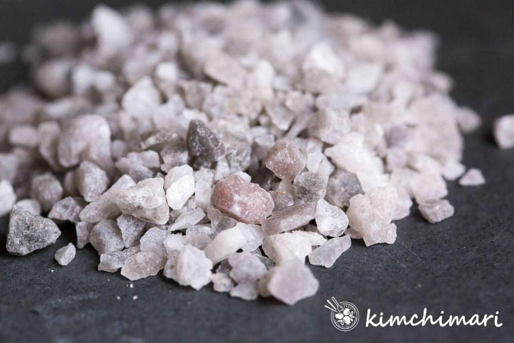 closeup of korean bamboo salt pile on black slate