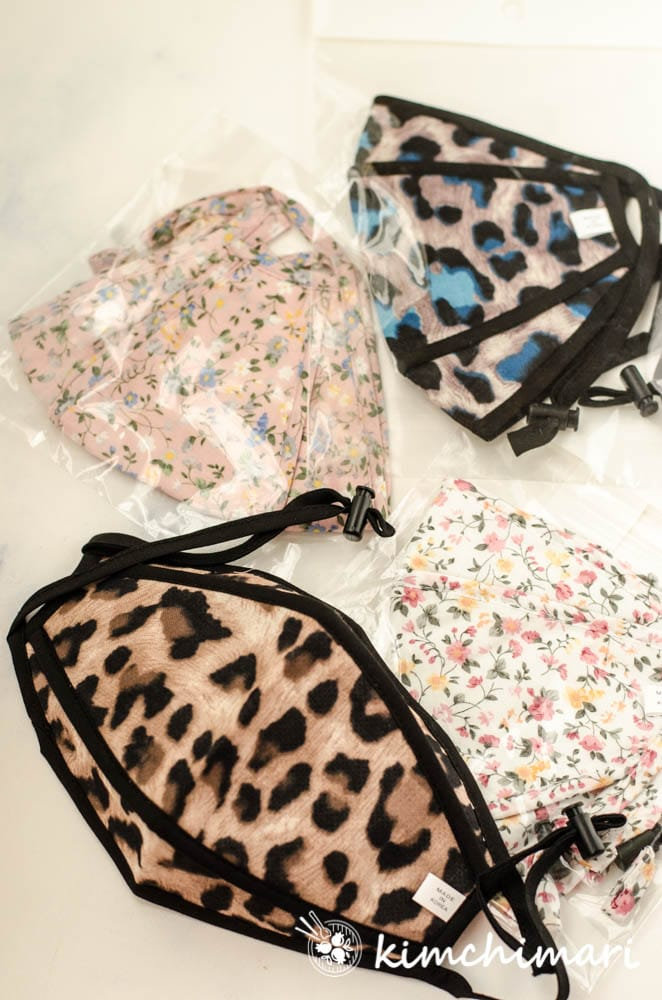 4 fabric masks with animal print patterns and flowers