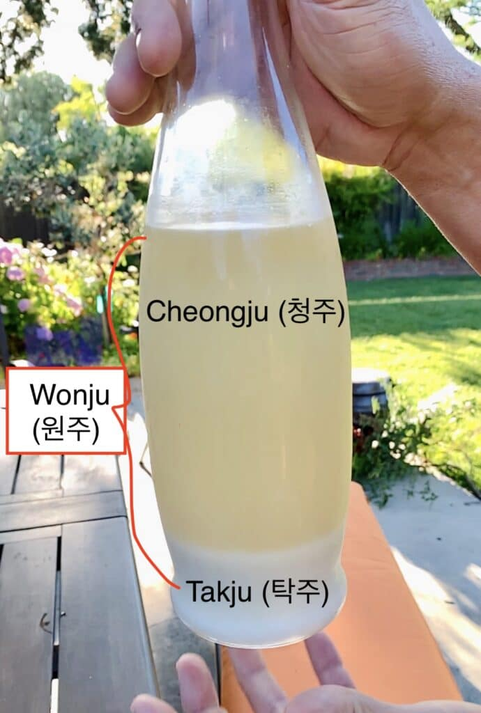pic of bottled rice liquor - showing bottom layer of sediments and clearer liquid above