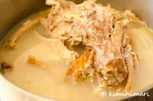 turkey bone broth in pot with carcass in pot