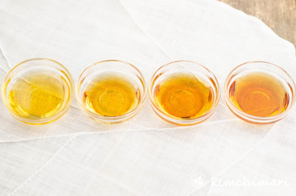 4 different color sesame oil in small glass bowls from light to dark