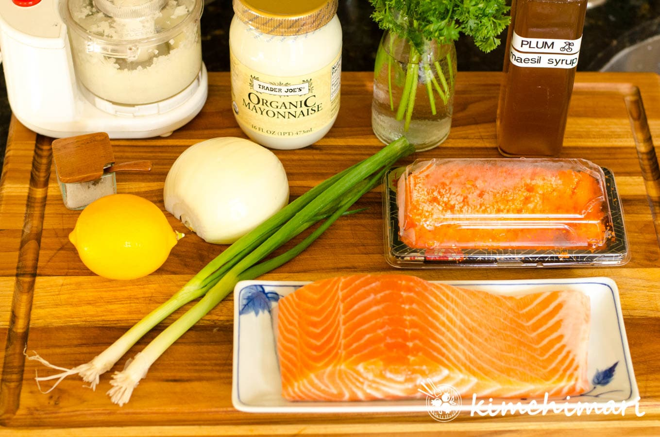 ingredients for baked salmon laid out on wood cutting board